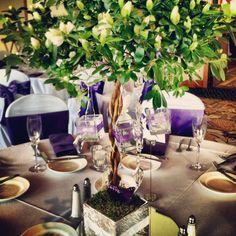 Azalea bush centerpiece with purple accents. #azaleas #centerpiece #weddings #candles #pretty #food