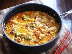 Easy red curry recipe using tons of veggies and spicy sausage.
