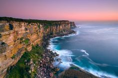 Sunrise over rugged coastline of north head in Sydney Harbor National Park, Sydney, New South Wales_ Australia