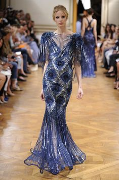 "· Zuhair Murad's ""Enchanted Forest"" F/W 2013-2014 Collection consisted of iridescent little twigs embroidered on nude tulle dresses. They were either flowing or whirled into hourglass s…"