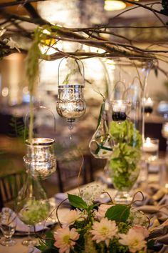 Branch Centerpiece with Hanging Votives | photography by http://justindemutiisphotography.com/