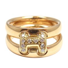 HERMES Diamond H Yellow Gold Flex Ring | From a unique collection of vintage cluster rings at http://www.1stdibs.com/jewelry/rings/cluster-rings/