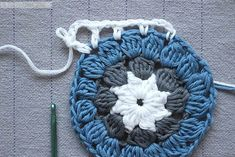 A modern, dahlia-inspired crochet granny square pattern by Eline Alcocer at  Emmy + LIEN. Includes step-by-step written instructions and a photo  tutorial.