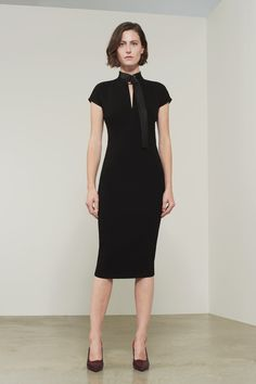 This is an fitted midi dress with capped sleeved and feminine slash front detail. Cut from bonded crepe in black, it fits neatly against the body and the signature full-length back zip is inserted to accentuate the streamlined silhouette. Model is 180cm/ 5 foot 11inches tall and wears a UK size 8/US 4/36FR This style r