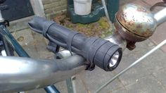 Attach a Maglite to your bike with inner tubes Led Work Light, Work Lights, Recycled Bike Parts, Pocket Light, Mini Bike, Led Flashlight, Outdoor Lighting, Candle Holders, Bicycle