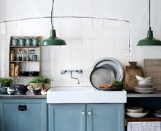 Whisperingblue - blue rustic kitchen.  Love the sink and light fixtures.  And kind of like the color of cabinets