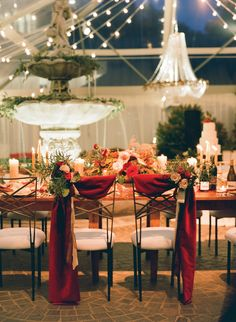 Bride and groom chair decor with scarlet fabric draping and autumn florals. Florals by Southern Blooms by Pat's Floral Designs, event design by Shindig Weddings & Events. Image by Jen Fariello.