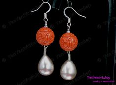 """Double Happiness"" is the design on the round Coral charm of this pair of earrings.   Beneath the Coral bead is a Silvery Shell Pearl of excellent quality in the shape of a Drop. The size of the Pearl is 12 x 16 mm."