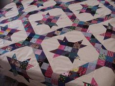 one of my favorite quilts made with scraps of fabric leftover from dresses I made for my granddaughters