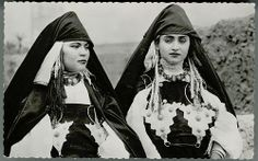 Two women with Cone-Shaped Headdresses and wearing necklaces and Fibulas of Zina Siaras, 1959, Berber