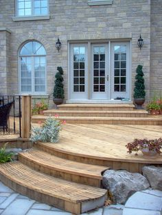 South facing deck idea: a set of steps by the sliding patio door would reduce the steps required down from the deck to grass.