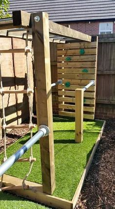 Outside jungle gym made from fence posts and metal bars from an old swing