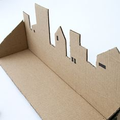 Make a trinket shelf of a cardboardbox. Tutorial in Swedish and English.