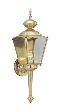"Beveled Glass 21"" Outdoor Wall Lantern in Polished Brass by Designers Fountain. $8.89. 1113-CL-PB Features: -One light wall lantern.-Clear glass.-UL and CUL listed. Color/Finish: -Polished brass finish. Specifications: -Accommodates (1) 100W max Edison medium base bulb (not included). Dimensions: -Overall dimensions: 21'' H x 6.5'' W x 7'' D."