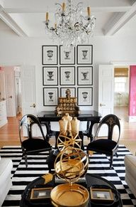 living room, striped rug, seating, black and white, chandelier, art wall, interiors, decor