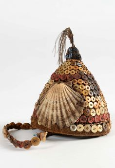 Africa | Hat / headgear from the Lega people of DR Congo | Vegetal fiber, various shells, buttons, elephant hair and glass beads