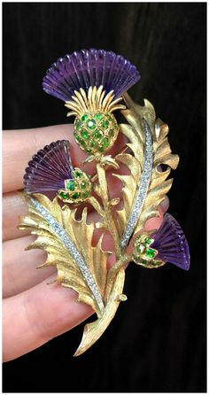 7d9fa77f24 A stunning vintage thistle brooch from Wilson s Estate Jewelry. Carved  amethyst