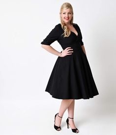 Let Delores get domestic with you, darling. A bewitching black frock rich in plus size 1950s vintage dress appeal fresh from Unique Vintage, Delores is unparalleled! Boasting a gathered surplice v-neckline, trim and tailored half sleeves with darling butt