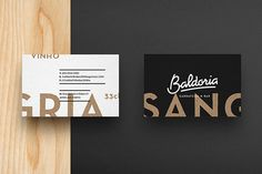 Two-sided business cards in black and white.