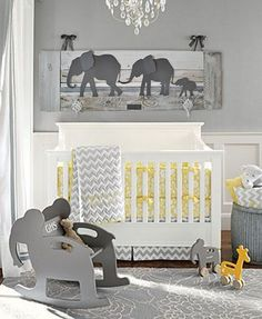 Elephant nursery decor. Unique wall art for a baby's room. Made of metal and reclaimed wood. Available in grey, pink, and natural wood. Check it out!