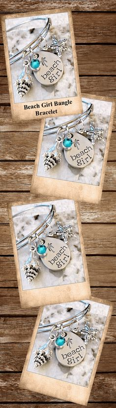 """This hand stamped bangle bracelet has a stamped pendant and is a pewter teardrop shape. It is stamped with """"Beach Girl"""" and a palm tree! This beautiful bracelet includes an aqua channel set Swarovski crystal, Tibetan silver shell, and Tibetan silver starfish charm accents. Perfect for any beach or ocean lover."""