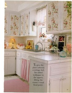 Sweet kitchen...love the wallpaper on the cabinets!
