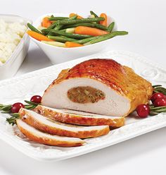 STUFFED TURKEY BREAST - Expertly seasoned, boneless, solid cut turkey breast stuffed with our exclusive dressing made from turkey meat, breadcrumbs, vegetables and savoury spices. Cook from frozen in just 2 hours to feed a family of Stuffed Turkey, Meat Shop, Food Retail, Turkey Breast, Salmon Burgers, Roast, Spices, Frozen, Pork