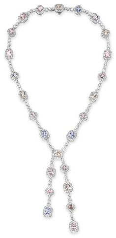 A DIAMOND AND MULTI-COLORED SAPPHIRE NECKLACE, BY TIFFANY & CO.   The collet-set diamond neckchain set with a series of modified rectangular and square-cut multi-colored sapphires, ranging from blue to pink to purple, suspending a multi-colored sapphire and collet-set diamond staggered tassel of similar design, mounted in platinum, 15¾ ins.  Signed Tiffany & Co., no. 21490784