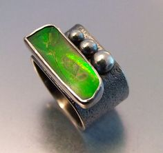 ENVY RING by melodyarmstrong  ||  Materials: Sterling silver, ammolite  ||  $746.05