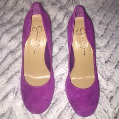 Jessica Simpson purple heel! Great heel. Super cute. Wear with any color. Add a pop of color to any outfit. Small spot on the side but very unnoticeable. Jessica Simpson Shoes Heels