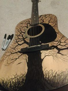 So I was bored during a snow day! The finish on my Pawn Shop Takamine had cracked, my Mom's watercolor tree painting inspired me, and I found some sharpies!                                                                                                                                                                                 More