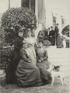 Alexandra and Dagmar (sitting), with their mother, Queen Louise of Denmark, and younger sister, Thyra, Crown Princess of Hanover and Duchess of Cumberland.