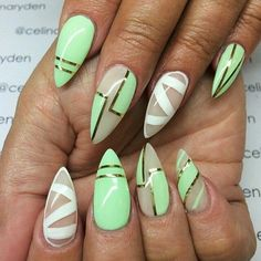 Light green and white nails with gold trim and negative space designs