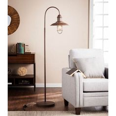 Pinsley Caged Bell Floor Lamp - Southern Enterprises meets contemporary in this rustic brown floor lamp. Wide-brimmed bell houses an antique style cage shade as a pebbled, textured finish covers the entire piece. Turn on ambient lighting wit Farmhouse Floor Lamps, Rustic Floor Lamps, Industrial Floor Lamps, Farmhouse Flooring, Rustic Lamps, Brown Floor Lamps, Arc Floor Lamps, Wholesale Furniture, Candelabra Bulbs