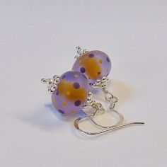 Purple & yellow lampwork glass sterling silver earrings by Craftybeadsbysam on Etsy https://www.etsy.com/uk/listing/514483833/purple-yellow-lampwork-glass-sterling
