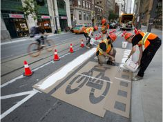 Bike lane pilot project in Toronto being installed on Richmond and Adelaide one way streets July 2014