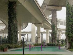 People Sure Get Creative With the Space Under Highway Overpasses | A park with colorful gymnastics equipment sits under an overpass, Shanghai, China. | Credit: Gisela Erlacher | From Wired.com