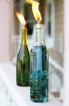 Replace your old, weathered tiki torches with beautiful, colorful DIY wine bottle citronella candles. Replace your old, weathered tiki torches with beautiful, colorful DIY wine bottle citronella candles. Reuse Wine Bottles, Wine Bottle Art, Wine Bottle Crafts, Bottles And Jars, Diy Bottle, Empty Bottles, Wine Bottle Candles, Wine Corks, Wine Bottle Torches