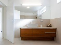 Teak veneer is completely safe for the bathroom when it gets the right surface treatment to block it from moisture. We are building in a wide range of sanitary devices into our bathroom furniture. Bathroom Furniture, Bathroom Interior, Teak, Bathtub, Mirror, Surface, Building, Range, Interior Ideas