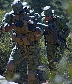"""Navy SEALs on patrol. SCAR-H in foreground has suppressor. The Spirit of God says: """"Russia, that's right Russia, I will use Russia, the United States of America and her allies, to take on the 4th Reich called lSlS. For it has come full circle again, that's right again. The New World Order is trying to rise and take its' place, just like they did in WWII, using the Nazi's. They will try again using lSlS. For this plague is spreading but not for long, for they will be wiped out for their…"""