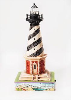 """Jim Shore Heartwood Creek  NORTH CAROLINA COASTAL LIGHTHOUSE  """"Beware The Diamond Shoals""""    America's lighthouses offer some of the most spectacular views imaginable. Let this lighthouse offer a spectacular view in your home.  Specifications  Inspired by Cape Hatteras  Beacon lights up  9 1/2"""" H  Materials : Stone Resin.    Your Price: $45.00"""