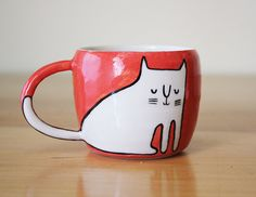He encontrado este interesante anuncio de Etsy en https://www.etsy.com/es/listing/232023262/coral-red-and-white-double-espresso-cup