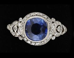 A platinum, blue sapphire and diamond 1930s ring. Art Deco