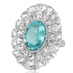 Sutra ring set with a Paraiba tourmaline and rose-cut diamonds, encircled by a diamond halo, in white gold