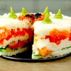 You may think a sushi cake is difficult to make, but actually, it is even easier than making real sushi! Buy the classic ingredients, like salmon, cucumber, sushi rice and sushi nori and use a round cake pan to layer everything. That's it!