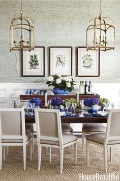 A wallpaper with a delicate pattern and a very large repeat creates interest in a dining room. Design by Andrew Howard
