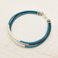 Turquoise Aqua Blue Leather & Sterling Silver Bracelet / by byjodi, $52.00