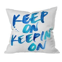 """White DENY Designs pillow with a watercolor-inspired inscription.   Product: PillowConstruction Material: Woven polyesterColor: Blue and whiteFeatures:  Concealed zipperMade in the USAInsert includedDesigned by CMYKaren for DENY Designs Dimensions: 18"""" x 18""""Cleaning and Care: Spot treat with mild detergent"""