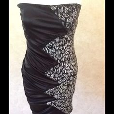 """Black and Silver Cocktail Dress A black and silver stretchy cocktail dress. Accented with black and silver sequins. 100% polyester with no zipper. Has a 32"""" bust, 26"""" waist. Marked a size medium but is a junior size so runs small. Should fit a size 4-8. Deb Dresses"""