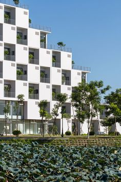 Vo Trong Nghia Architects has completed an office building at Hanoi's FPT University featuring modular prefabricated facades.